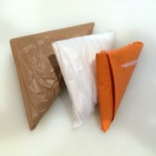 Three plastic bags folded using a football fold.
