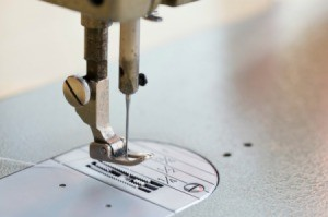 The foot and needle of a sewing machine.