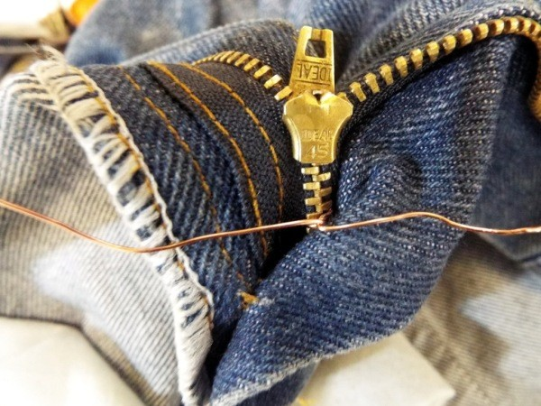Sewing a stop into the zipper fly of jeans.