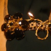 Recycled Jewelry Barrettes - barrette decorated with floral jewelry piece with dark topaz like stones