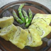 plate with cut tamagoyaki and asparagus