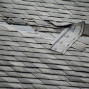 Roof with damaged shingles.