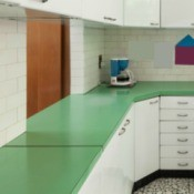 Old kitchen with green laminate countertops.