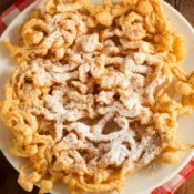 Funnel cake, made by deep drying cake batter.