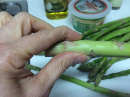 snapping ends off asparagus