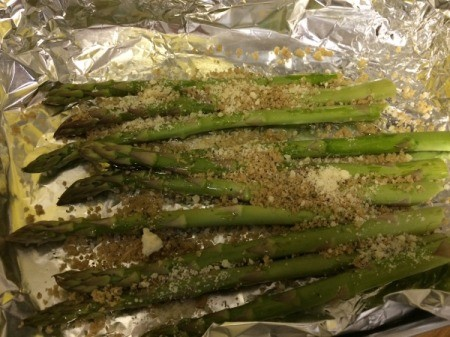 sprinkling parmesan on asparagus