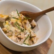 A bowl of chicken salad made with rosemary.