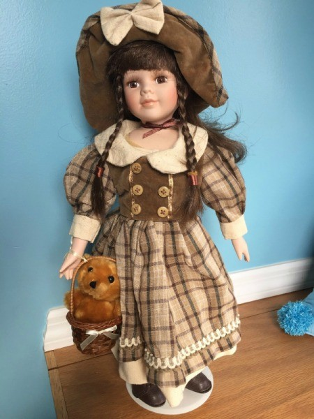 Identifying Porcelain Dolls - doll in brown plaid dress with hat