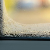 A window with water condensation.