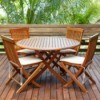 A teak wood deck with teak wood furniture on it.
