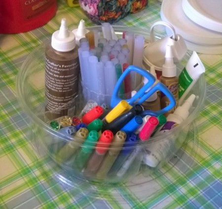 Recycled Fruit Container for Craft Supplies - clear plastic container filled with craft supplies