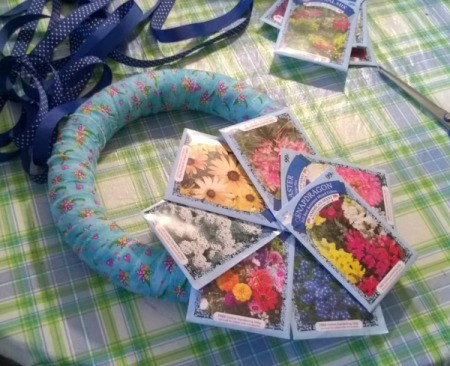 Spring Seed Packet Wreath - fan out seed packets to look like a flower and glue to each other and to the wreath