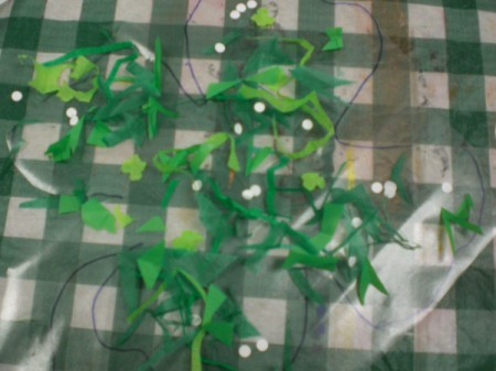Shamrock Suncatcher - cut out a second square of contact paper peel and stick to decorated one. Smooth out bubbles.  Cut shamrock shape now.