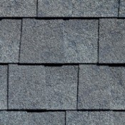 A row of shingles on a wall or roof.