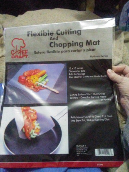 Flexible cutting and chopping mat in a package.