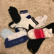 A pile of mismatched socks on the floor.