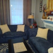 Curtain and Accent Pillow Color Advice - blue couch with curtains in background and pillow on couch