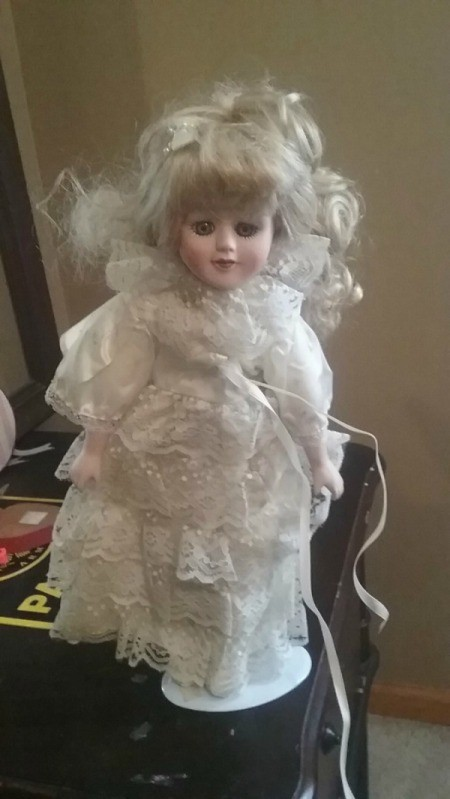 Value of Porcelain Doll - doll wearing a white lace dress