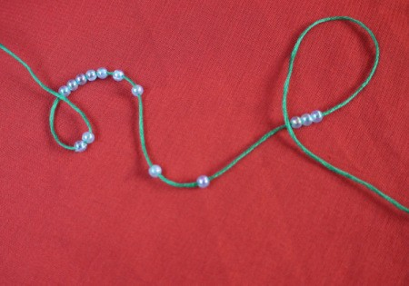 Paperclip and Bead Wrapped Earrings - thread beads onto floss