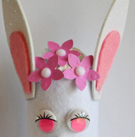 Upcycled Easter Bunny Craft - punch pink flowers from card stock and glue to head adding a rhinestone to the centers