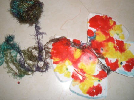 Make a Spring Butterfly from a Paper Plate - add pipe cleaner under yarn and shape for antenna