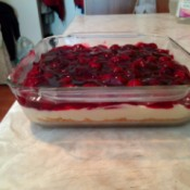 A no bake cherry cheesecake in a sheet pan.