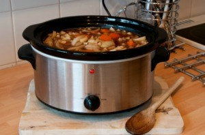 A pot of soup in a slow cooker.