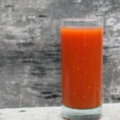 A tall glass of tomato juice.