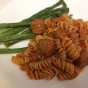 Spaghetti and Meatballs on plate with asparagus
