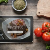 A tablet with recipe software showing on the screen.