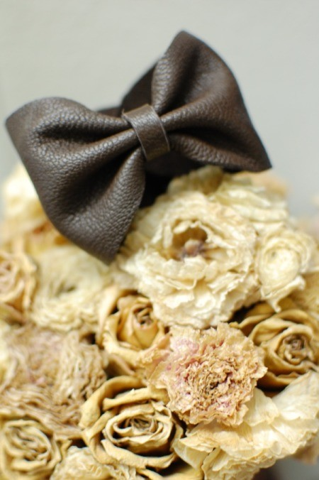 DIY Leather Bow Bracelet - bracelet on bouquet of dried roses