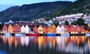 Houses reflected in the water in Norway.