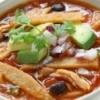 A bowl of chicken tortilla soup.