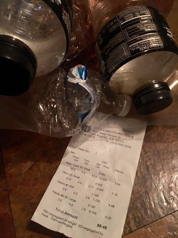 Recycled bottles with a receipt.