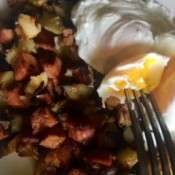 A plate of corned beef hash and eggs.