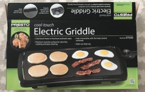 Presto Jumbo Cool Touch Electric Griddle in a box.