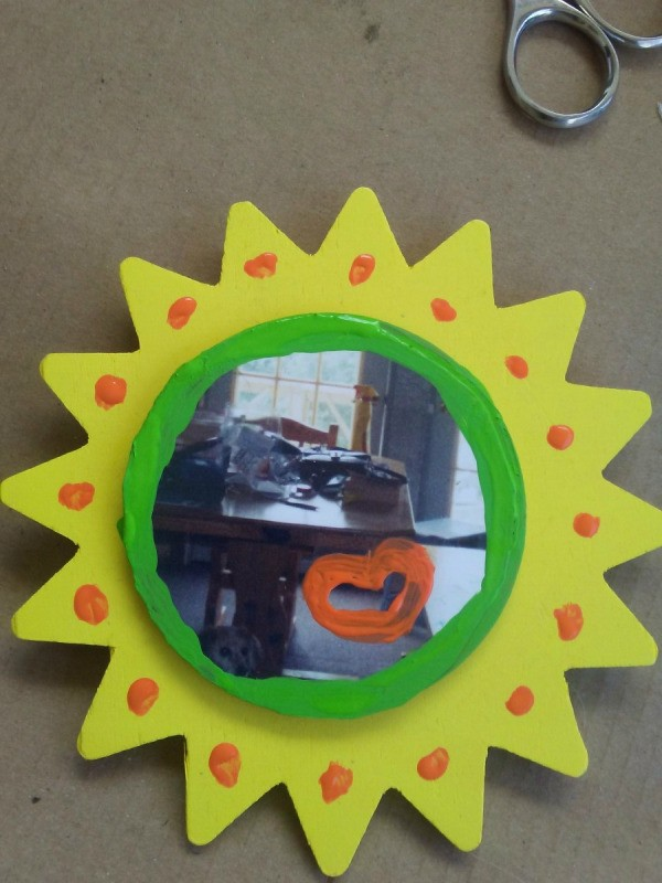 A photo magnet made with Modge-Podge.