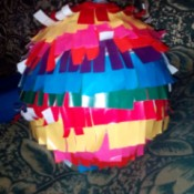 DIY Piñata - balloon wrapped with fringed paper - allow to dry