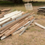 A pile of scrap lumber at a construction site.