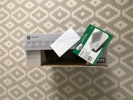 A product box with receipt and manual, saved in case of a return.