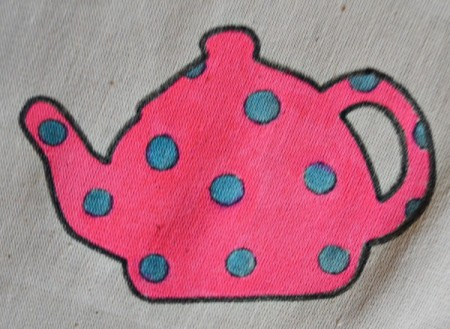 Tea is Served! - Tea Tray Cloth - Now color the background of each teapot and again iron the cloth before continuing with the next step. - closeup of pink pot with blue dots