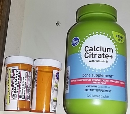Prescription bottles in a medicine cabinet.
