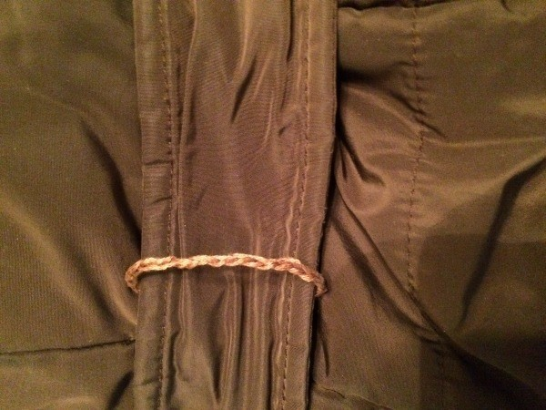 A belt loop on a jacket.