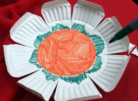 Paper Plate Flower - orange center with green scallops around center