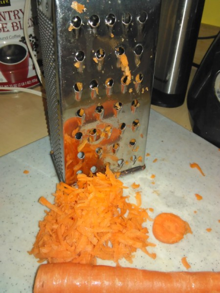 grater and grated carrot
