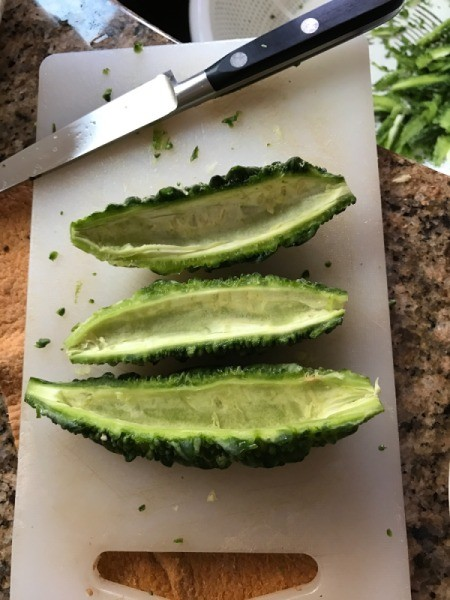 Karela Bitter Meloncut in half lengthwise with seeds removed