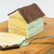 House shaped cake with the end slice off.