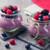 Blackberry Pudding topped with berries.