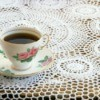 Crochet Tablecloth with a cup of tea on it.