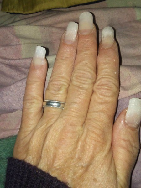 A set of acrylic nails without polish.